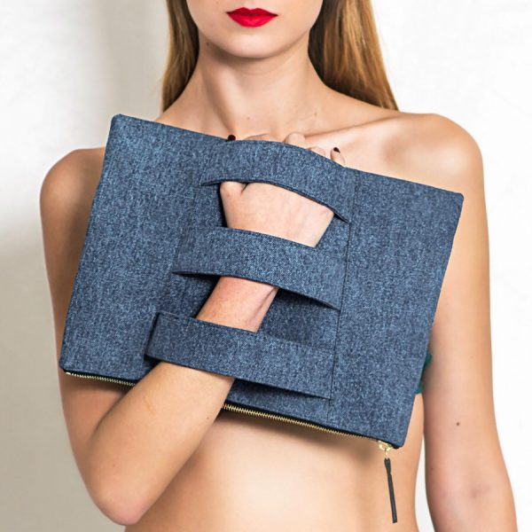Clutch bag with 3 arm straps made from up cycled denim jeans