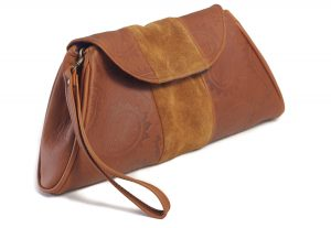Tan embossed leather clutch bag with suede panel side view
