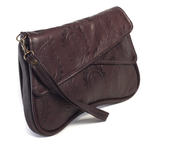 Chocolate brown paisley embossed leather clutch bag with detachable wrist strap side view