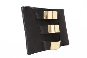 Clutch bag featuring 3 recycled brass bombshell cuffs on chrome free vegetable tanned leather