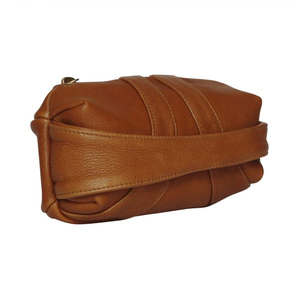 Capsule shaped tan leather clutch bag with hand strap across the front. Side view.